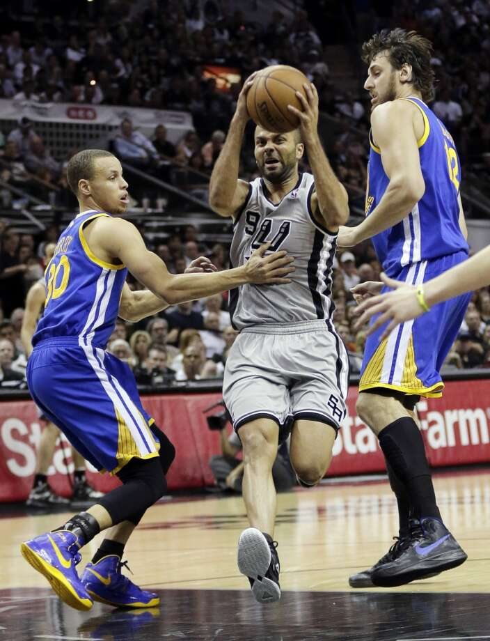 The Spurs' Tony Parker (9) drives between the  Warriors' Stephen Curry (30) and Andrew Bogut during the first half of Game 2 in their Western Conference semifinal NBA basketball playoff series, Wednesday, May 8, 2013, in San Antonio.