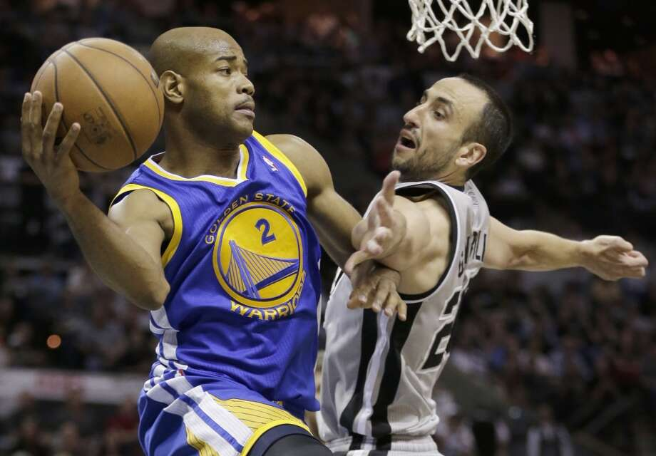 The Warriors' Jarrett Jack (2) passes around the Spurs' Manu Ginobili (20), of Argentina, during the second half in Game 2 of a Western Conference semifinal NBA basketball playoff series, Wednesday, May 8, 2013, in San Antonio. Golden State won 100-91.
