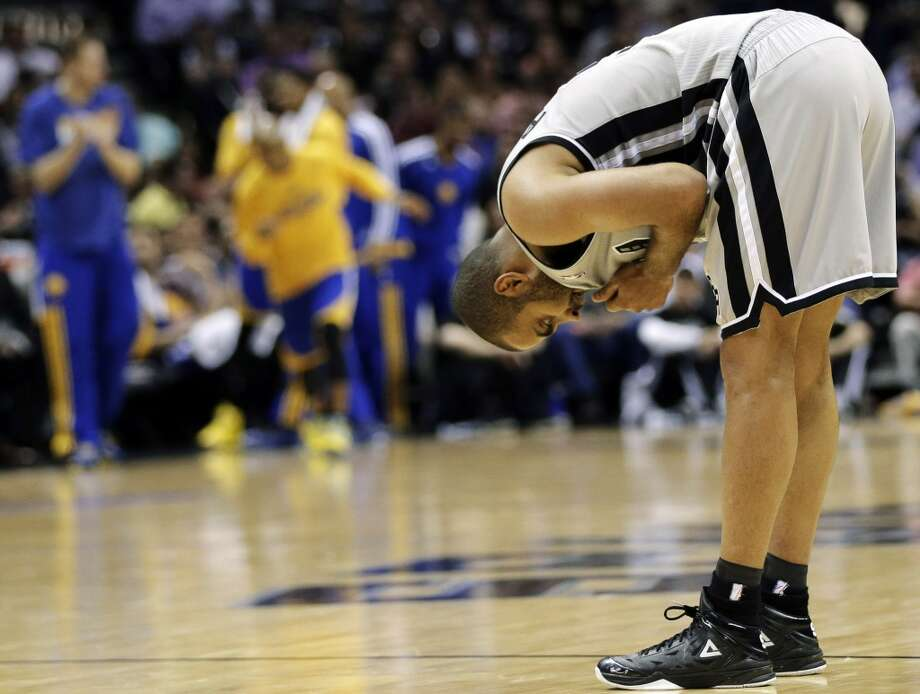 The Spurs' Tony Parker (9) catches his breath during the second half in Game 2 of their Western Conference semifinal NBA basketball playoff series against the Golden State Warriors, Wednesday, May 8, 2013, in San Antonio.