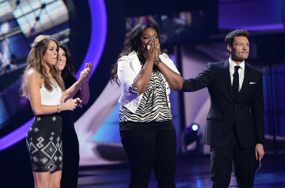 AMERICAN IDOL: Candice Glover Advances to the finals on AMERICAN IDOL Thursday, May 9 (8:00-9:00 PM ET/PT) on FOX. L-R: Angie Miller, Kree Harrison, Candice Glover and Ryan Seacrest. CR: Michael Becker / FOX. Copyright: FOX.