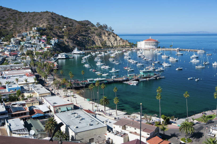 Avalon, Catalina Island: An hour-long ferry ride from Long Beach (or a 15-minute helicopter trip - if that's how you roll) brings you to this Mediterranean-style village, which hugs Avalon Bay. While there is plenty of shopping and dining to be had on the main promenade, Crescent Avenue, the activities taking place in the clear waters just offshore — snorkeling, kayaking, parasailing, scuba diving — are the real draw. If all that ocean frolicking tuckers you out, take a spin around town in one of the many golf carts for rent (full-size vehicles are restricted on the island, so golf carts are the local go-to for transportation). Photo: Matthew Micah Wright, Getty Images/Lonely Planet Images / Lonely Planet Images