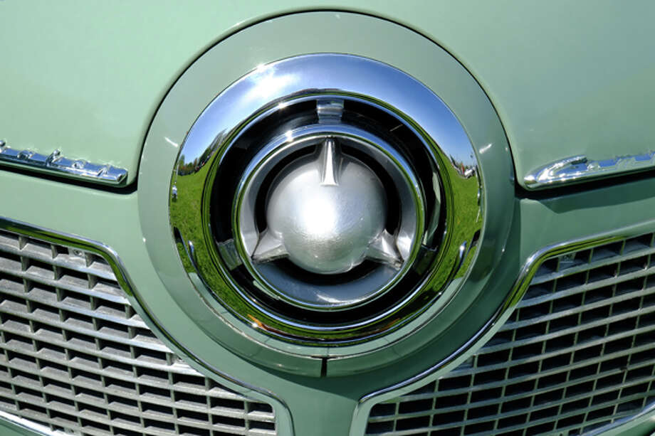 The famous Studebaker bullet nose.  Painted outer ring on the airplane design cap marks it as a '51, not a '50. / copyright: Dan Lyons - 2013