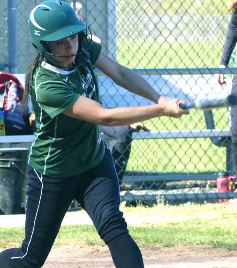 The Green Wave's Vienna Pallisco delivers yet another hit during a 12-1 victory for New Milford High School softball over Pomperaug, May 1, 2013 at NMHS. Photo: Norm Cummings