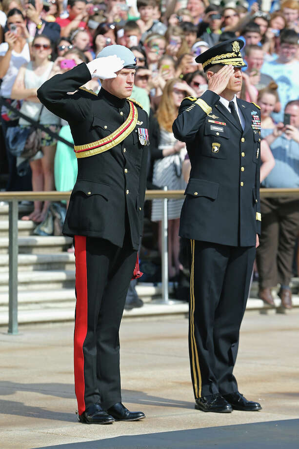 HRH Prince Harry wearing his No. 1 ceremonial uniform of The Blues and Royals as he pays his respects to the victims of the Afghanistan conflict and the tomb of the unknown soldier accompanied by Major General Michael Linnington during the second day of his visit to the United States at Arlington National Cemetery on May 10, 2013 in Arlington, Virginia. HRH will be undertaking engagements on behalf of charities with which the Prince is closely associated on behalf also of HM Government, with a central theme of supporting injured service personnel from the UK and US forces. Photo: Chris Jackson, Getty Images / 2013 Getty Images