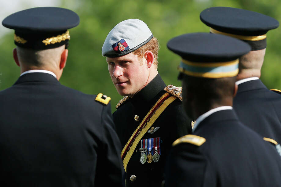 Prince Harry of Great Britain, wearing his British Army ceremonial uniform of the Blues And Royals in his role as Captain Harry Wales, is accompanied by military officials  as he visits Section 60 of Arlington National Cemetery, where veterans of the wars in Iraq and Afghanistan are buried, on May 10, 2013 in Arlington Virginia. During his visit to the US, Prince Harry will be undertaking engagements on behalf of charities with which he is closely associated, on behalf also of HM Government, with a central theme of supporting injured service personnel from the UK and US forces. Photo: Pool, Getty Images / 2013 Getty Images