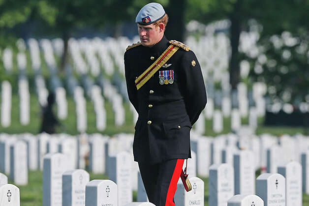 Prince Harry of Great Britain, wearing his British Army ceremonial uniform of the Blues And Royals in his role as Captain Harry Wales, visits Section 60 of Arlington National Cemetery, where veterans of the wars in Iraq and Afghanistan are buried, on May 10, 2013 in Arlington Virginia. During his visit to the US, Prince Harry will be undertaking engagements on behalf of charities with which he is closely associated, on behalf also of HM Government, with a central theme of supporting injured service personnel from the UK and US forces. Photo: Pool, Getty Images / 2013 Getty Images