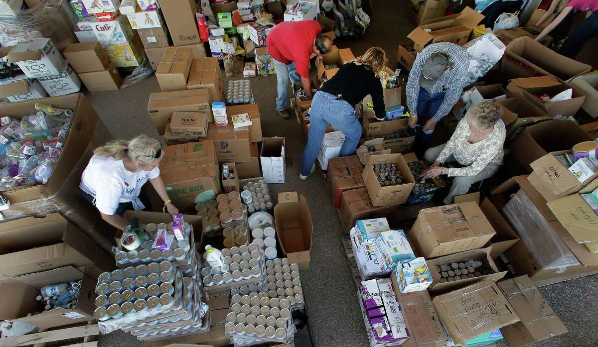 Volunteers sort through donated goods in West on Monday.