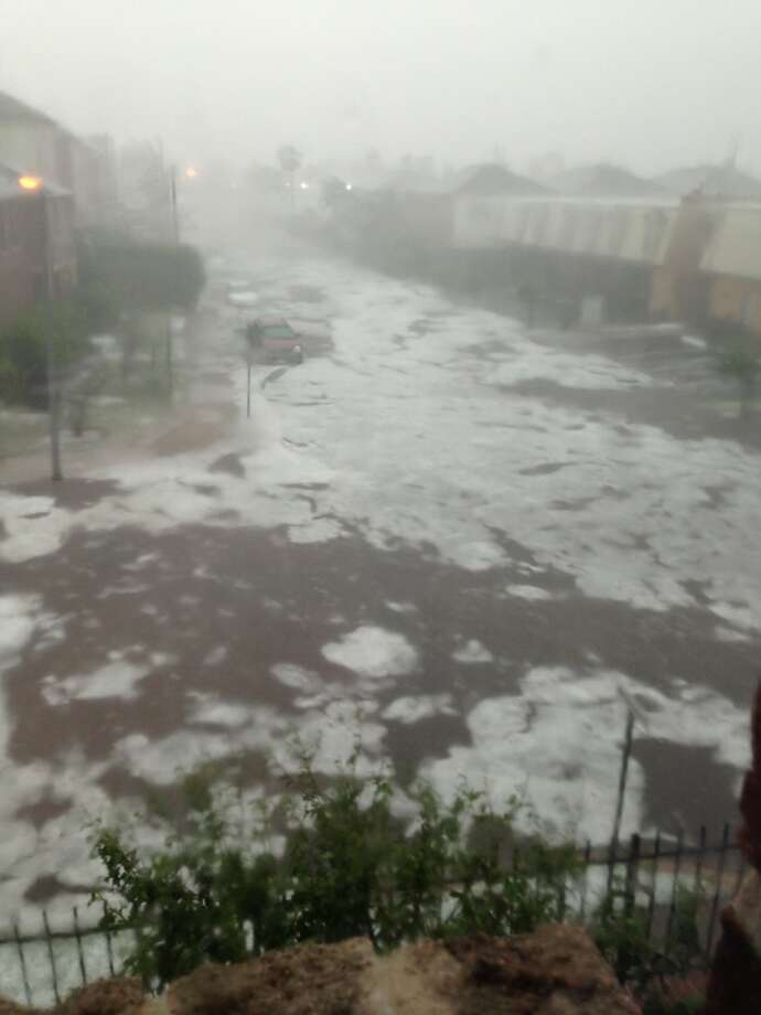 Hail floating in floodwaters from Saturday.