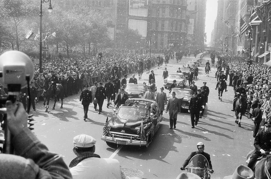 1957:  Queen Elizabeth II and her entourage make their way through New York City during an official visit to the States. Photo: Ernst Haas, Getty Images / Ernst Haas