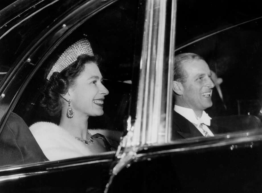 1957: HM, Queen Elizabeth accompanied by the Duke of Edinburgh in good spirits on their US tour. Photo: Popperfoto, Popperfoto/Getty Images / Popperfoto