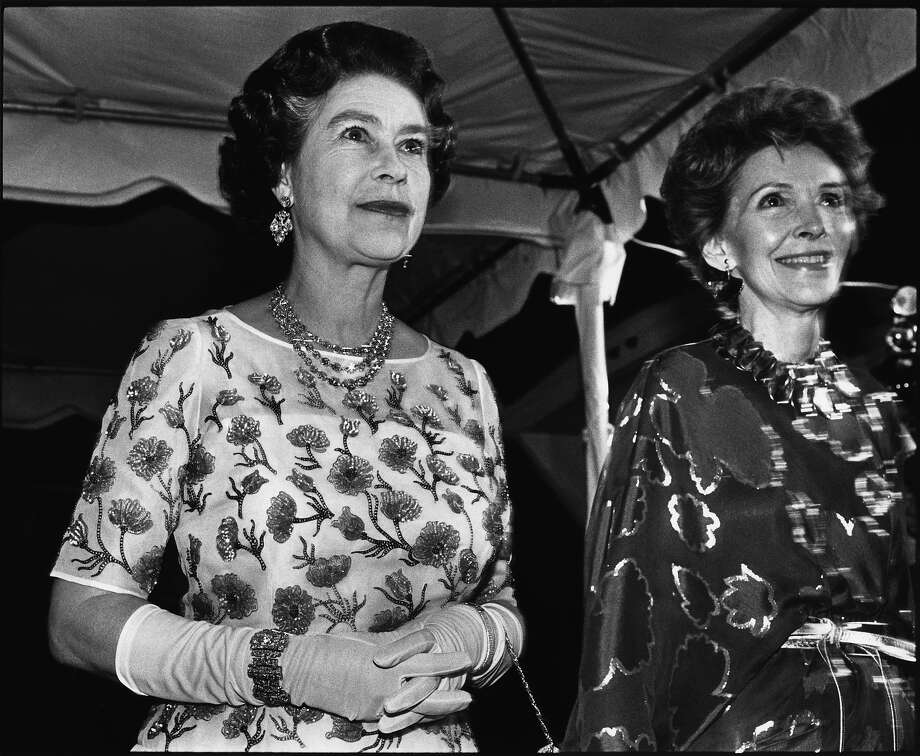 1982: Queen Elizabeth II is seen walking the red carpet with Nancy Reagan in this 1982 Los Angeles, California, taken during her weeklong visit to the States. Photo: George Rose, Getty Images / 1982 George Rose