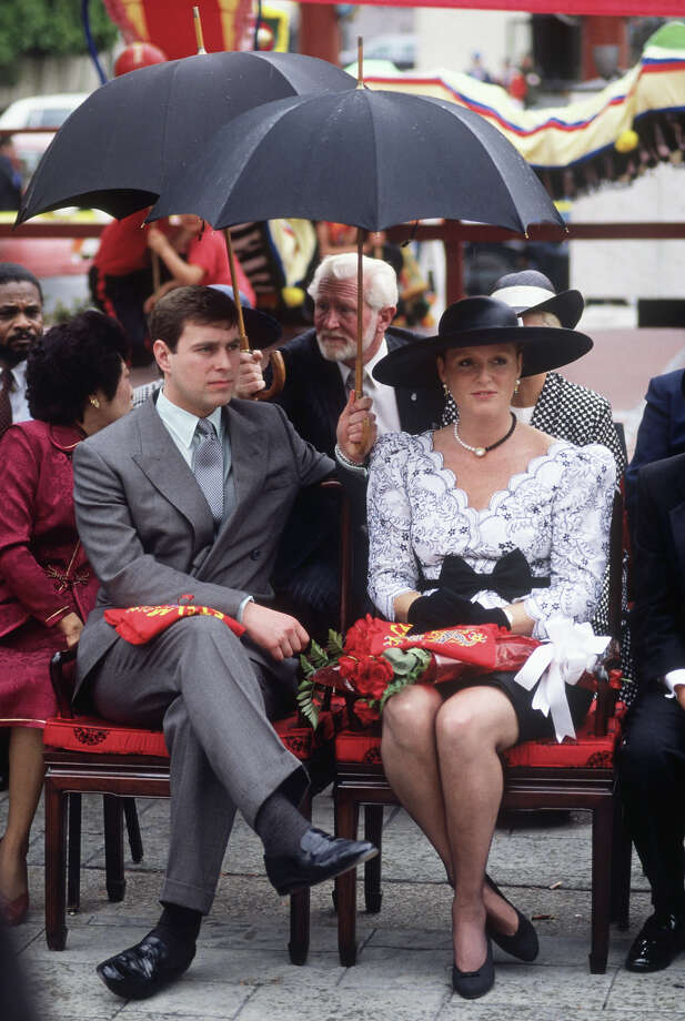 1988: Prince Andrew holds an umbrella over Sarah, Duchess of York while at an event in Los Angeles' Chinatown. Photo: David Levenson, Getty Images / 1988 David Levenson