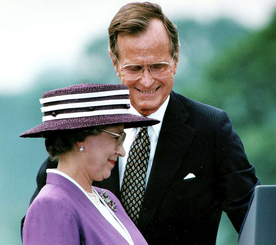 1991: President George Bush steps aside for Great Britain's Queen Elizabeth II to address the crowd attending a welcoming ceremony at the White House. Photo: JEROME DELAY, AFP/Getty Images / 2012 AFP