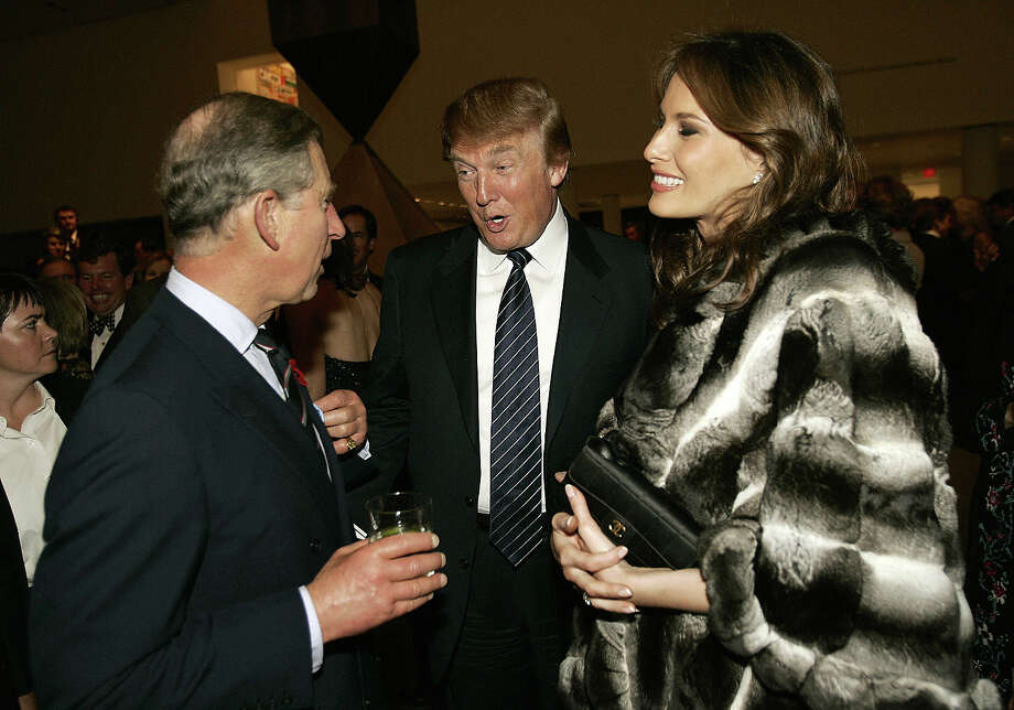 2005: Britain's Prince Charles (L) talks with Donald Trump (C) and his wife Melania (R) during a reception at the Museum of Modern Art 01 November 2005 in New York. Photo: TIMOTHY A. CLARY, AFP/Getty Images / 2005 AFP