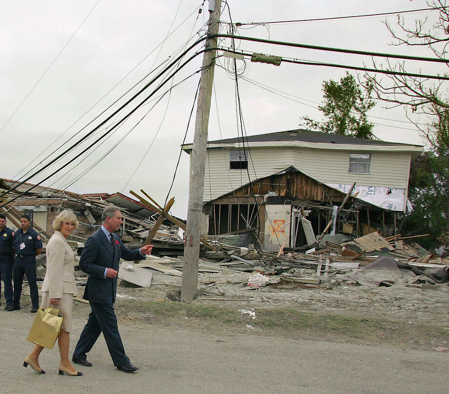 2005: Britain's Prince Charles and his wife Camilla, Duchess of Cornwall tour a levee in the 9th Ward of New Orleans that was breached by Hurricane Katrina. Photo: JAMES NIELSEN, AFP/Getty Images / 2005 AFP