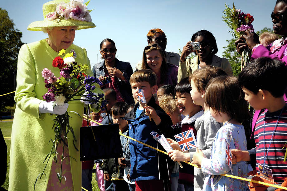 2007: HM Queen Elizabeth II is greeted by children on her walk from NASA?s Goddard Space Flight Center mission control to a reception in the center's main auditorium in Greenbelt, Maryland. Photo: Bill Ingalls/NASA, Getty Images / 2007 NASA