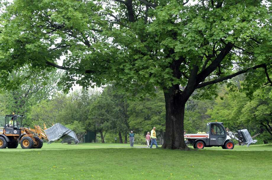 City crews set up for this weekend Tulip Festival at Washington Park on Thursday May 9, 2013 in Albany N.Y. (Michael P. Farrell/Times Union) Photo: Michael P. Farrell, Albany Times Union