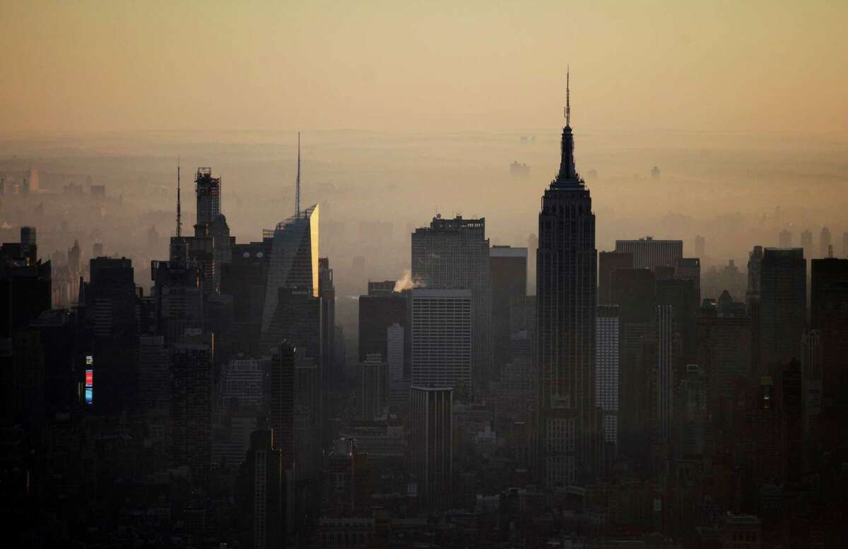 The view of The Empire State Building and the midtown Manhattan skyline is seen from the 105th floor of One World Trade Center, Friday, May 10, 2013 in New York. The addition of the final piece of spire, and its raising of the buildingÃ'Â's height to 1,776 feet, would make One World Trade Center the tallest structure in the U.S. and third-tallest in the world.