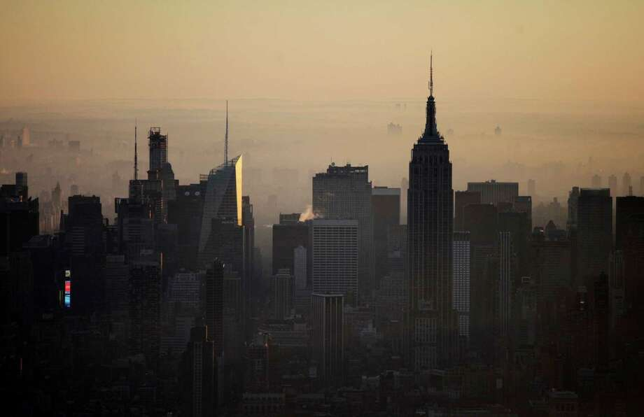 The view of The Empire State Building and the midtown Manhattan skyline is seen from the 105th floor of One World Trade Center, Friday, May 10, 2013 in New York. The addition of the final piece of spire, and its raising of the building's height to 1,776 feet, would make One World Trade Center the tallest structure in the U.S. and third-tallest in the world. Photo: Mark Lennihan, AP / AP