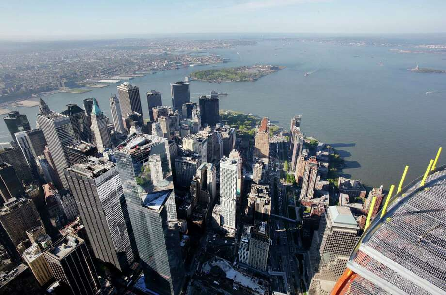 The view of lower Manhattan, below, and Brooklyn, upper left, as seen from the 105th floor of One World Trade Center, Friday, May 10, 2013 in New York. The addition of the final piece of spire, and its raising of the building's height to 1,776 feet, would make One World Trade Center the tallest structure in the U.S. and third-tallest in the world. Manhattan is lower left and Brooklyn is at  top. Photo: Mark Lennihan, AP / AP