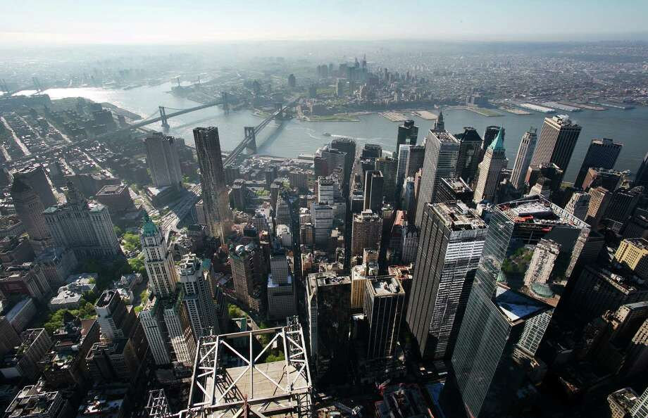 The view of the Manhattan, left, and brooklyn bridges as seen from the 105th floor of One World Trade Center, Friday, May 10, 2013 in New York. The addition of the final piece of spire, and its raising of the building's height to 1,776 feet, would make One World Trade Center the tallest structure in the U.S. and third-tallest in the world. Manhattan is lower left and Brooklyn is at  top. Photo: Mark Lennihan, AP / AP