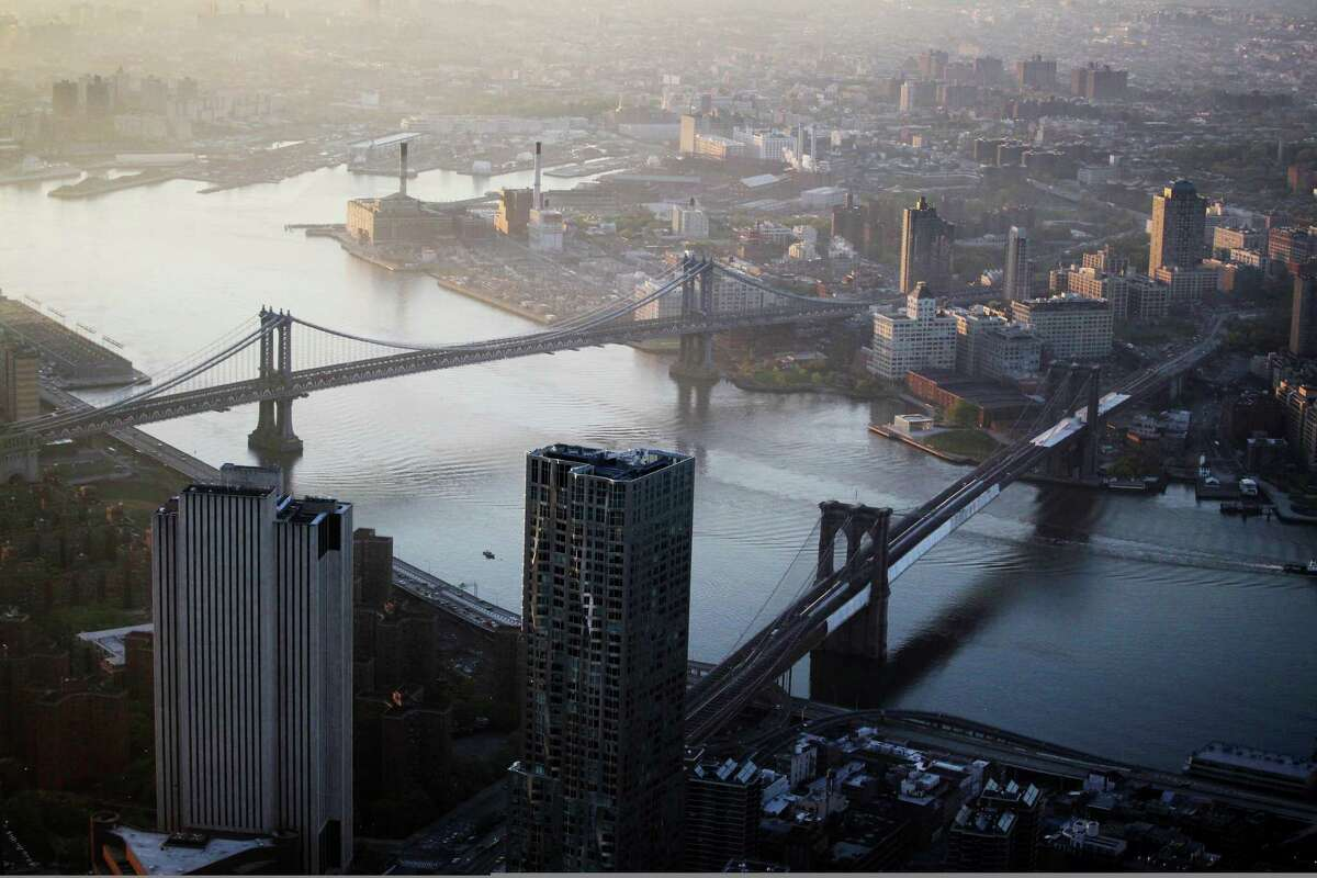 The view of the Manhattan Bridge, left, and Brooklyn Bridge as seen from the 105th floor of One World Trade Center, Friday, May 10, 2013 in New York. The addition of the final piece of spire, and its raising of the buildingÃ'Â's height to 1,776 feet, would make One World Trade Center the tallest structure in the U.S. and third-tallest in the world. Manhattan is lower left and Brooklyn is at top.