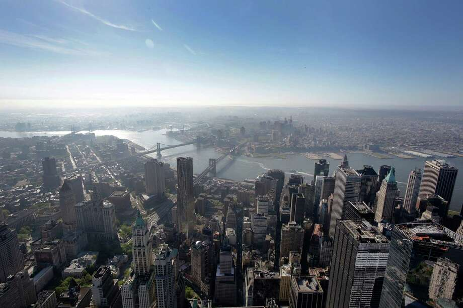 The view of lower Manhattan, below, and Brooklyn as seen from the 105th floor of One World Trade Center, Friday, May 10, 2013 in New York. The addition of the final piece of spire, and its raising of the building's height to 1,776 feet, would make One World Trade Center the tallest structure in the U.S. and third-tallest in the world. Manhattan is lower left and Brooklyn is at  top. Photo: Mark Lennihan, AP / AP