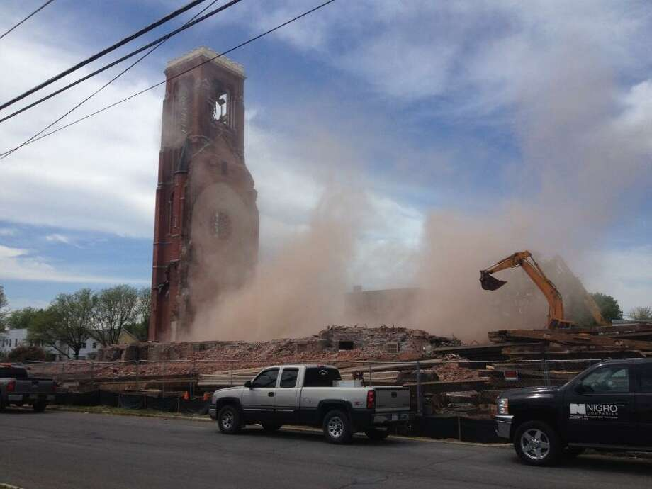 The tower at St. Patrick's Church begins to come down as a demolition crew begins the final stage in the leveling of the structure. (John Carl D'Annibale / Times Union)
