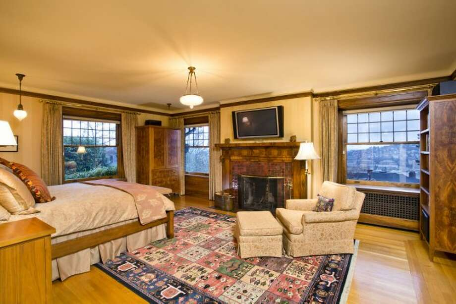 Master bedroom of the O.W. Fisher House, at 1039 Belmont Place E., which is now for sale. The 8,243-square-foot brick Tudor, built in 1913, has five bedrooms, 6.25 bathrooms, a library, a sun room, five fireplaces, wood walls, beamed ceilings, leaded glass, built-ins, a patio and views of Puget Sound, Lake Union and the Olympic Mountains on a 7,200-square-foot manicured lot. It's listed for $2.9 million. Photo: Courtesy Bob Bennion And Mary Snyder, Windermere Real Estate