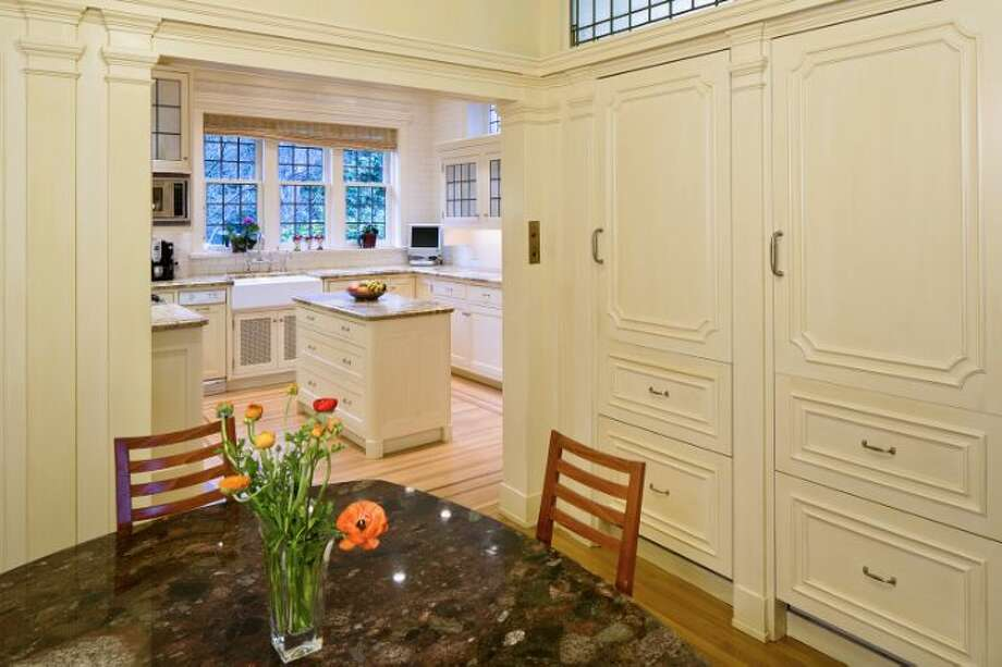 Kitchen eating area of the O.W. Fisher House, at 1039 Belmont Place E., which is now for sale. The 8,243-square-foot brick Tudor, built in 1913, has five bedrooms, 6.25 bathrooms, a library, a sun room, five fireplaces, wood walls, beamed ceilings, leaded glass, built-ins, a patio and views of Puget Sound, Lake Union and the Olympic Mountains on a 7,200-square-foot manicured lot. It's listed for $2.9 million. Photo: Courtesy Bob Bennion And Mary Snyder, Windermere Real Estate