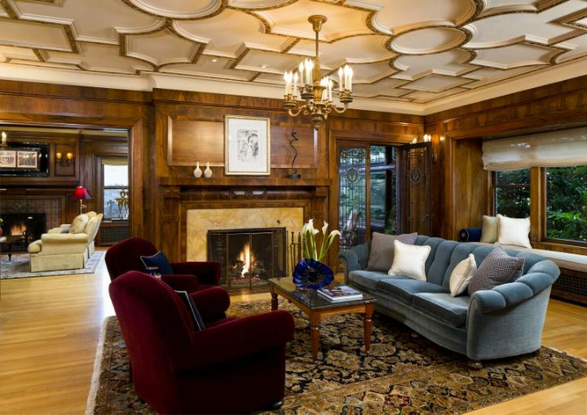 Living room of the O.W. Fisher House, at 1039 Belmont Place E., which is now for sale. The 8,243-square-foot brick Tudor, built in 1913, has five bedrooms, 6.25 bathrooms, a library, a sun room, five fireplaces, wood walls, beamed ceilings, leaded glass, built-ins, a patio and views of Puget Sound, Lake Union and the Olympic Mountains on a 7,200-square-foot manicured lot. It's listed for $2.9 million.