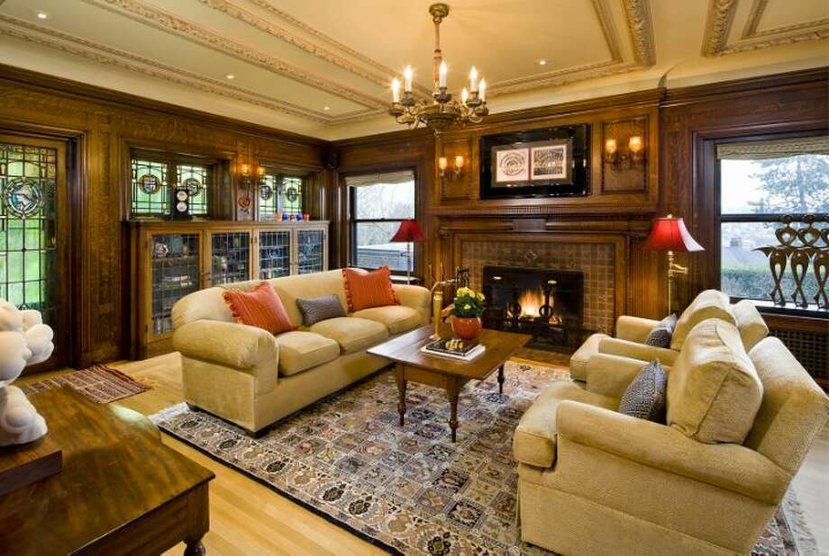 Library of the O.W. Fisher House, at 1039 Belmont Place E., which is now for sale. The 8,243-square-foot brick Tudor, built in 1913, has five bedrooms, 6.25 bathrooms, a sun room, five fireplaces, wood walls, beamed ceilings, leaded glass, built-ins, a patio and views of Puget Sound, Lake Union and the Olympic Mountains on a 7,200-square-foot manicured lot. It's listed for $2.9 million. Photo: Courtesy Bob Bennion And Mary Snyder, Windermere Real Estate