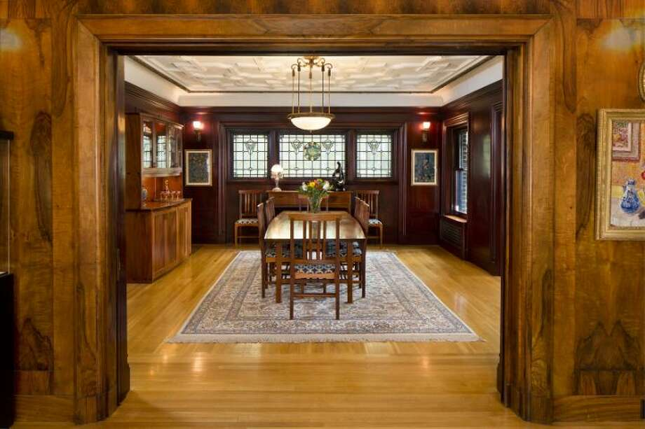 Dining room of the O.W. Fisher House, at 1039 Belmont Place E., which is now for sale. The 8,243-square-foot brick Tudor, built in 1913, has five bedrooms, 6.25 bathrooms, a library, a sun room, five fireplaces, wood walls, beamed ceilings, leaded glass, built-ins, a patio and views of Puget Sound, Lake Union and the Olympic Mountains on a 7,200-square-foot manicured lot. It's listed for $2.9 million. Photo: Courtesy Bob Bennion And Mary Snyder, Windermere Real Estate