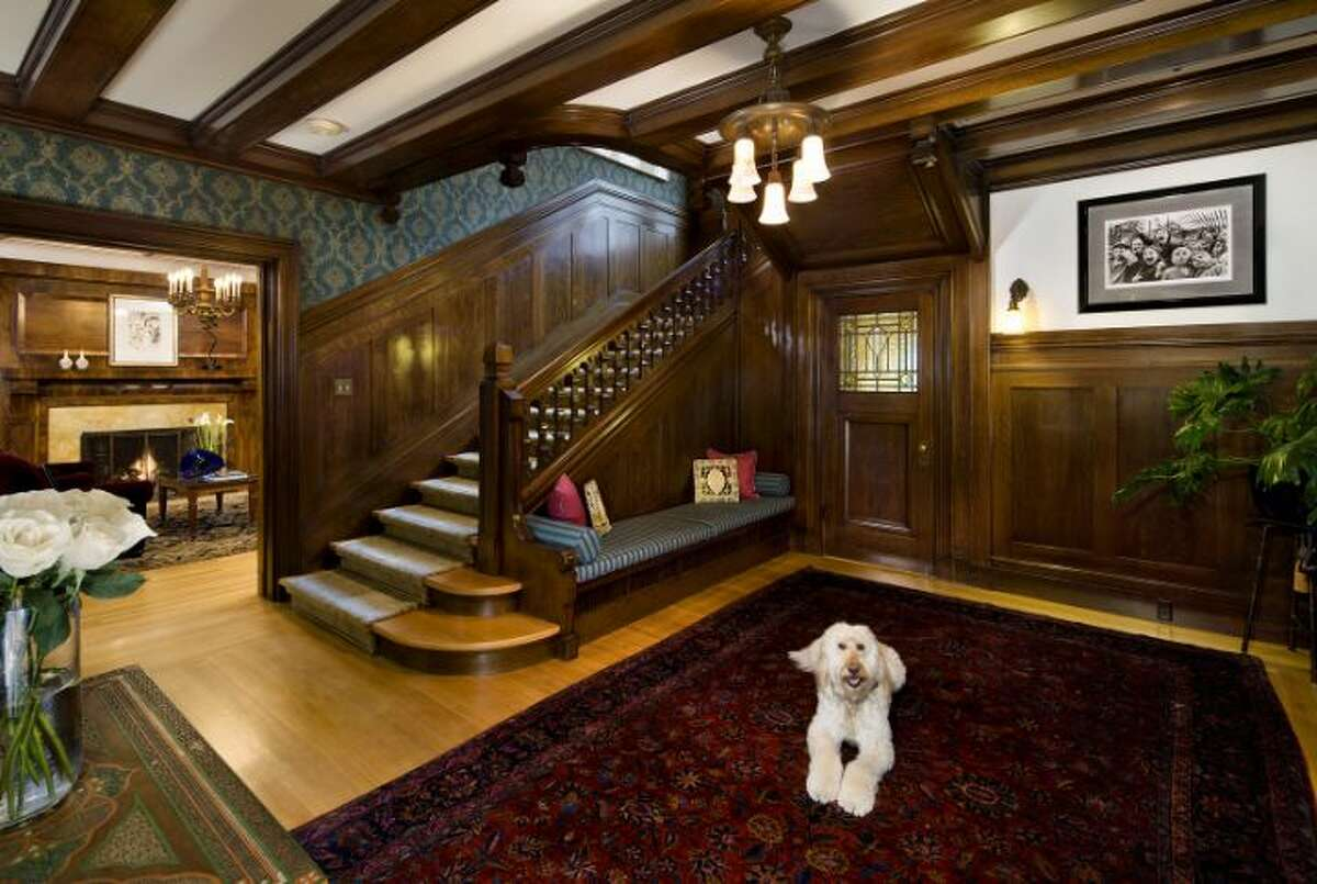 Foyer of the O.W. Fisher House, at 1039 Belmont Place E., which is now for sale. The 8,243-square-foot brick Tudor, built in 1913, has five bedrooms, 6.25 bathrooms, a library, a sun room, five fireplaces, wood walls, beamed ceilings, leaded glass, built-ins, a patio and views of Puget Sound, Lake Union and the Olympic Mountains on a 7,200-square-foot manicured lot. It's listed for $2.9 million.