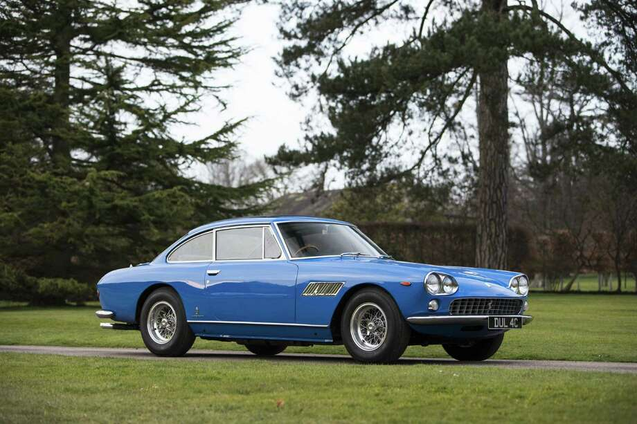 Bonhams is selling a 1965 Ferrari 330GT that was owned by Beatles singer John Lennon. Lennon famously bought the car after passing his driving test. Photo: Bonhams/Simon Clay
