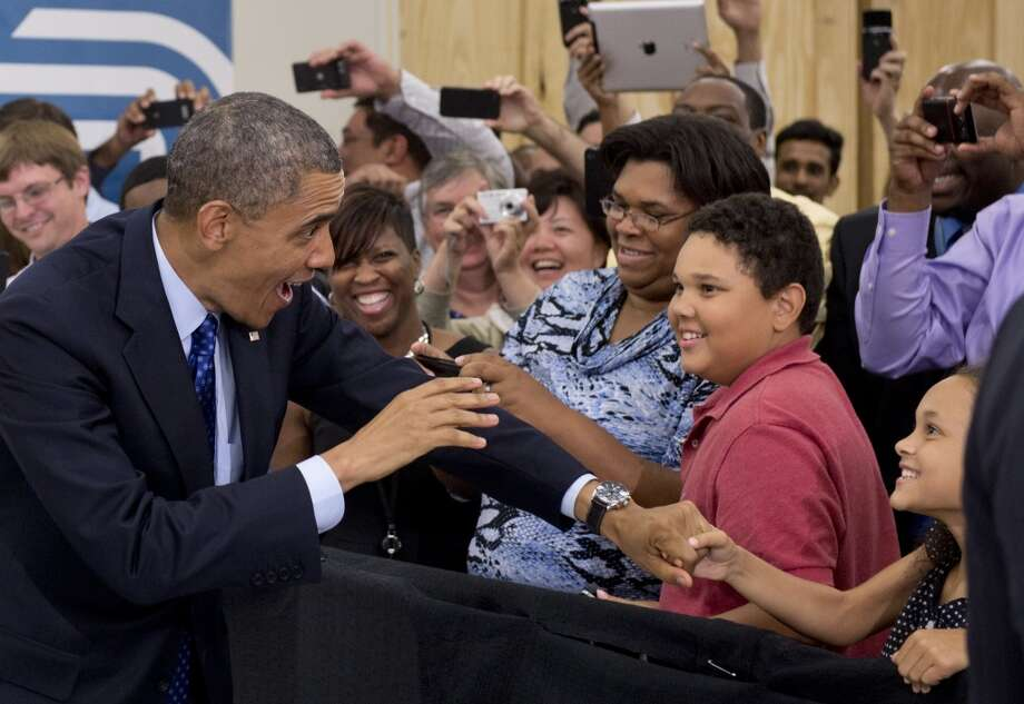 TOPSHOTS US President Barack Obama greets employees and their families prior to speaking on the economy and job creation at Applied Materials, a manufacturer of systems for polishing the surface of unfinished semiconductor chips, in Austin, Texas, May 9, 2013. AFP PHOTO / Saul LOEBSAUL LOEB/AFP/Getty Images
