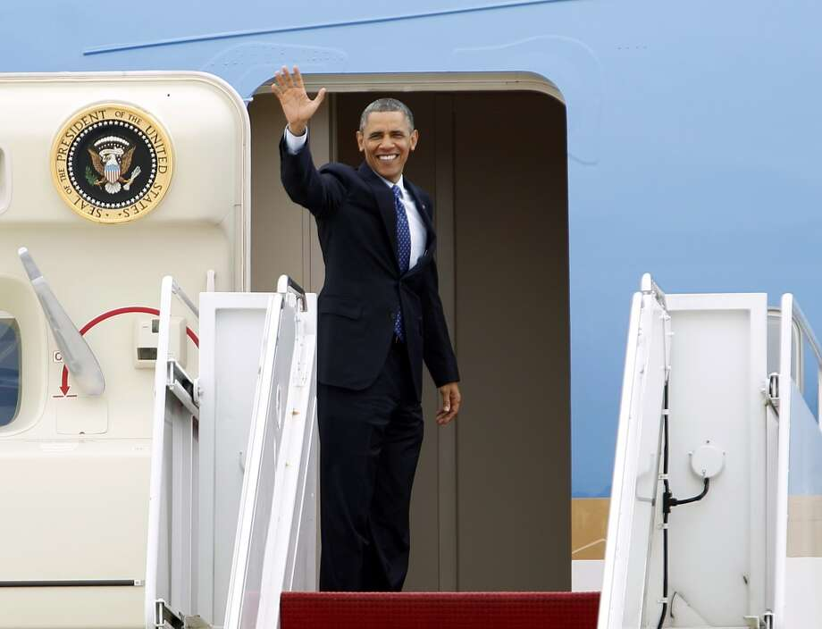 President Barack Obama waves prior to boarding Air Force One before departing from Andrews Air Force Base, Md., Thursday, May 9,  2013. Obama is traveling to Austin, Texas. ( AP Photo/Jose Luis Magana)