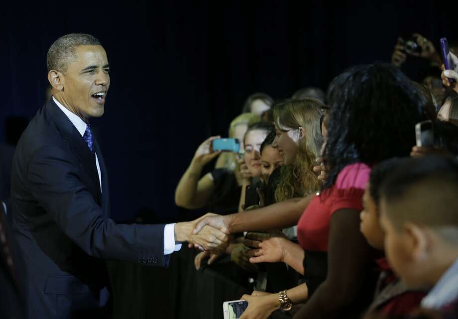 President Barack Obama, left, greets students as he is introduced during his visits Manor New Technology High School, Thursday, May 9, 2013 in Manor, Texas. (AP Photo/Pablo Martinez Monsivais)