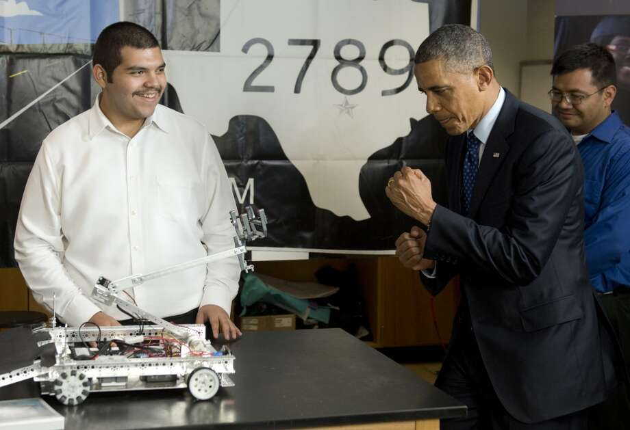 US President Barack Obama pretends to joust with a robot as he tours a classroom with student technology projects at Manor New Technology High School in Manor, Texas, May 9, 2013, prior to speaking on the economy and job creation. AFP PHOTO / Saul LOEBSAUL LOEB/AFP/Getty Images