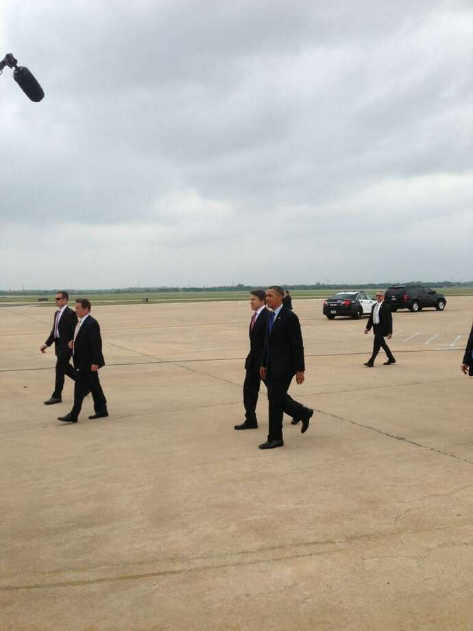 President Obama and Rick Perry on the tarmac.