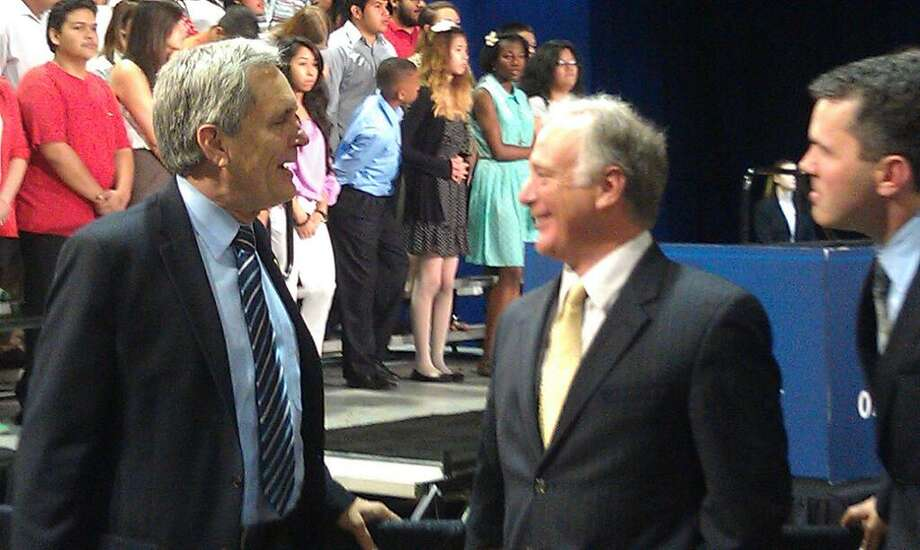 Congressman Lloyd Doggett and state Sen. Kirk Watson await President Obama's appearance in Austin.
