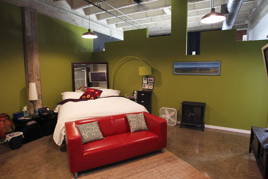 The green walls in Ken and Cindi Hack's loft were unplanned, but now much appreciated. The couple moved from Medina Lake to downtown. Photo: Photos By Tom Reel / San Antonio Express-News