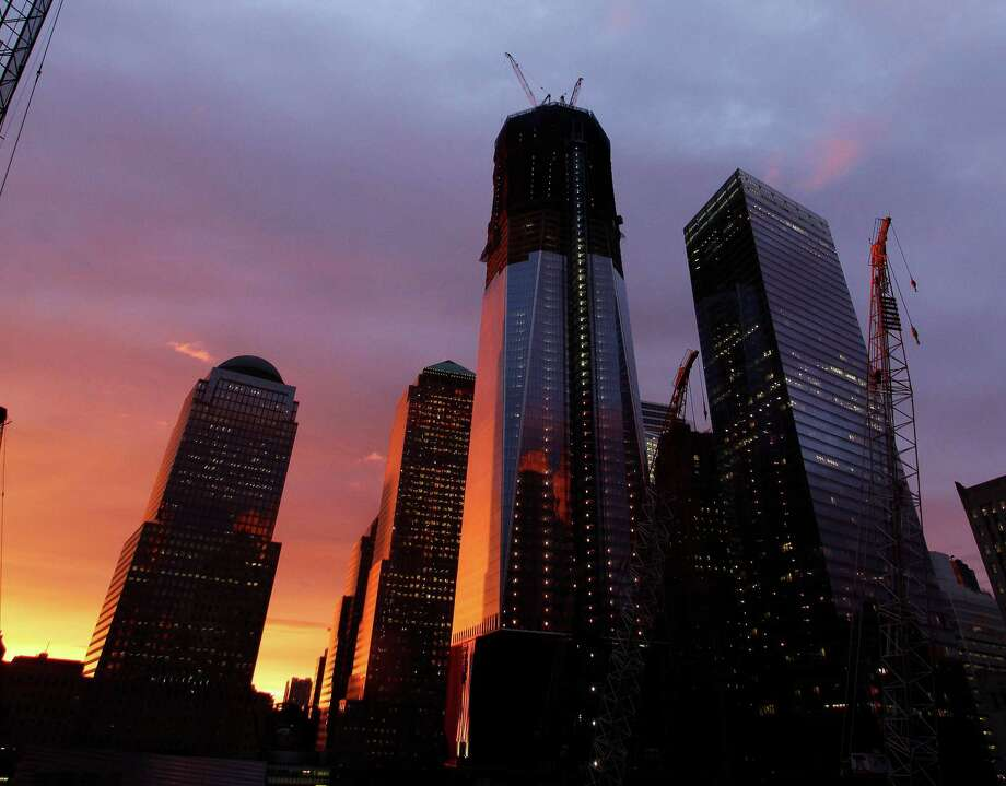 FILE - In this Sept. 15, 2011 file photo, the sun sets behind One World Trade Center, center, in New York. Photo: Mark Lennihan