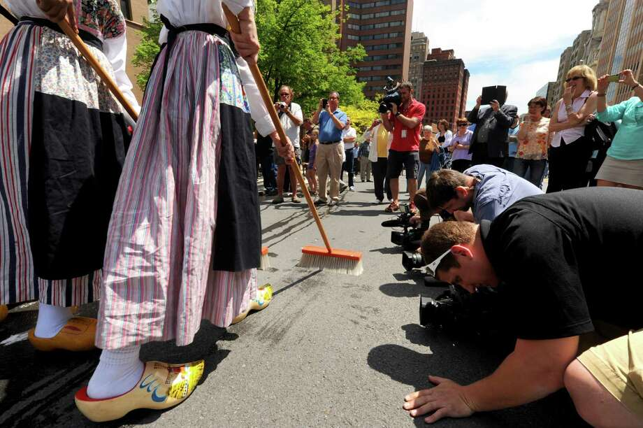 Albany High school students dressed in traditional Dutch garb perform the ritual street scrubbing to kick off Tulip Fest on Friday May 10, 2013 in Albany, N.Y. (Michael P. Farrell/Times Union) Photo: Michael P. Farrell