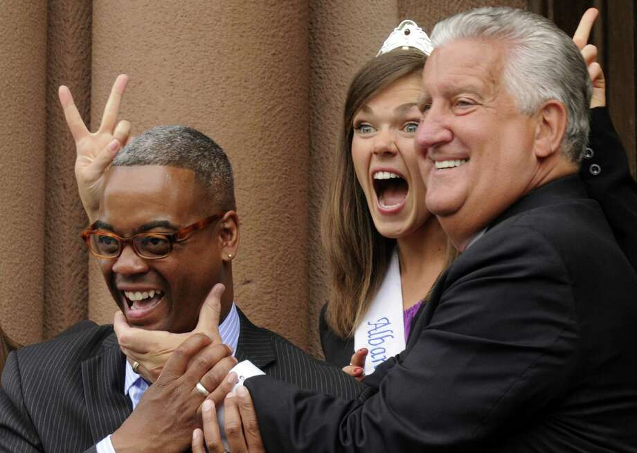 Tulip Fest Chairman Marcus Pryor, 2012 Albany Tulip Queen Emily Finnegan and Mayor Jerry Jennings have a good time during group photographs before the ritual street scrubbing to kick off Tulip Fest on Friday May 10, 2013 in Albany, N.Y. (Michael P. Farrell/Times Union) Photo: Michael P. Farrell