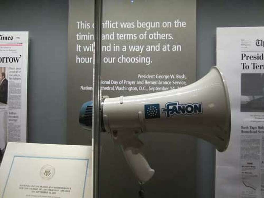 The bullhorn used by President Bush to address Ground Zero workers days after the 9/11 terrorist attack in New York is on display at the George W. Bush Presidential Library and Museum in Dallas. Staff/David Hendricks