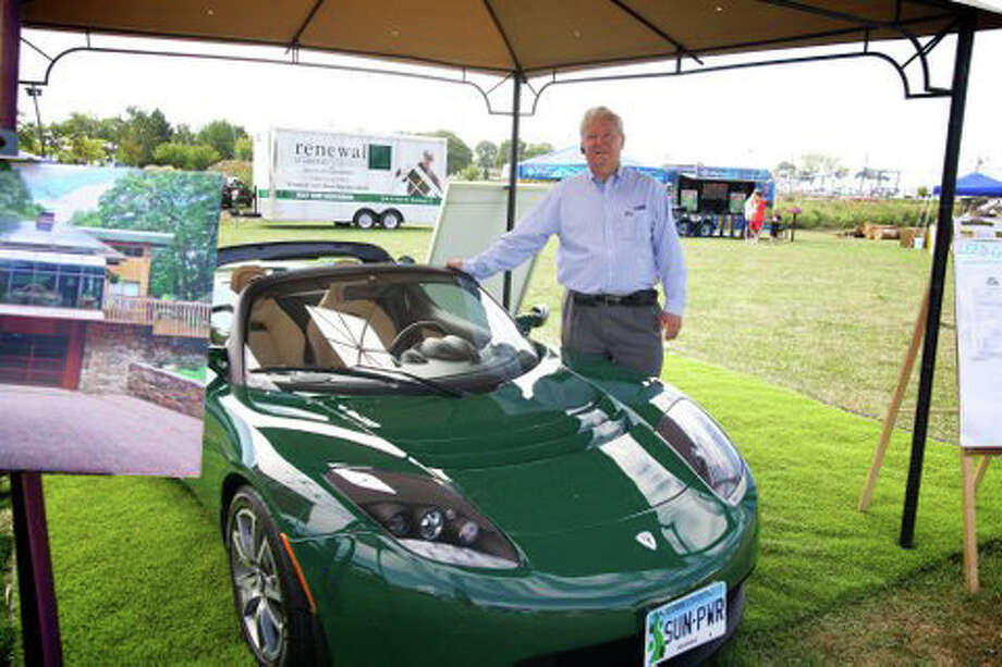 This file photo shows Ken Edwards, a real estate broker from Greenwich, with his Tesla Roadster. Photo: Contributed Photo
