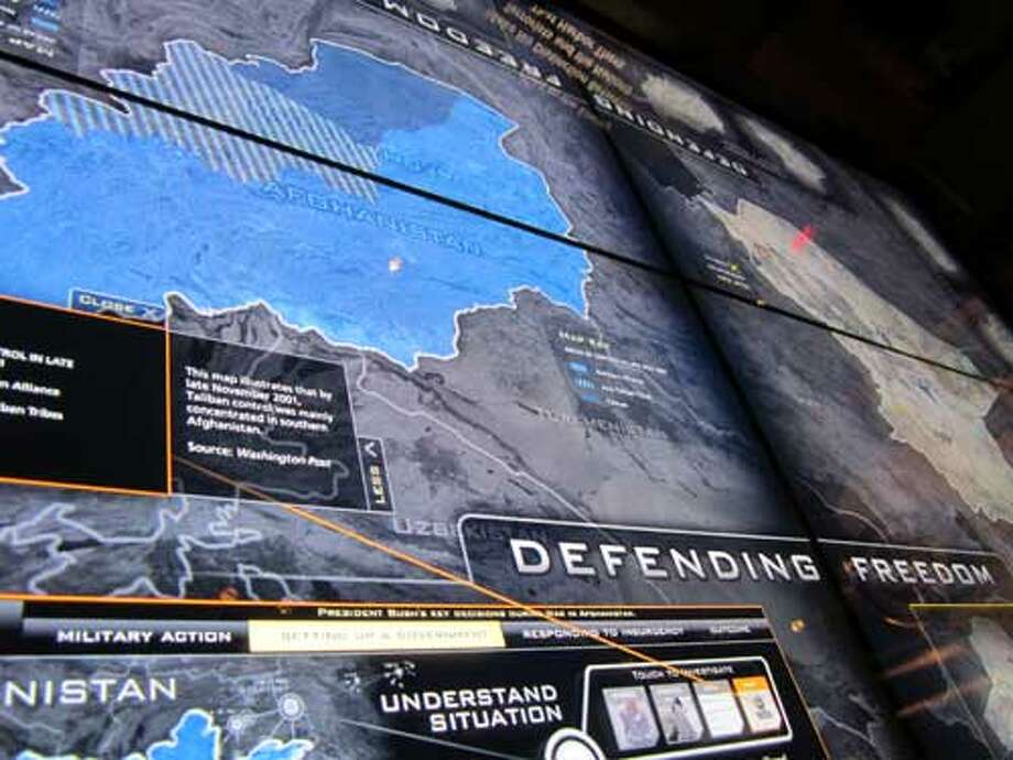 A touch-screen situation table at the George W. Bush Presidential Library and Museum in Dallas is an encyclopedia of information on the wars in Afghanistan and Iraq. Staff/David Hendricks