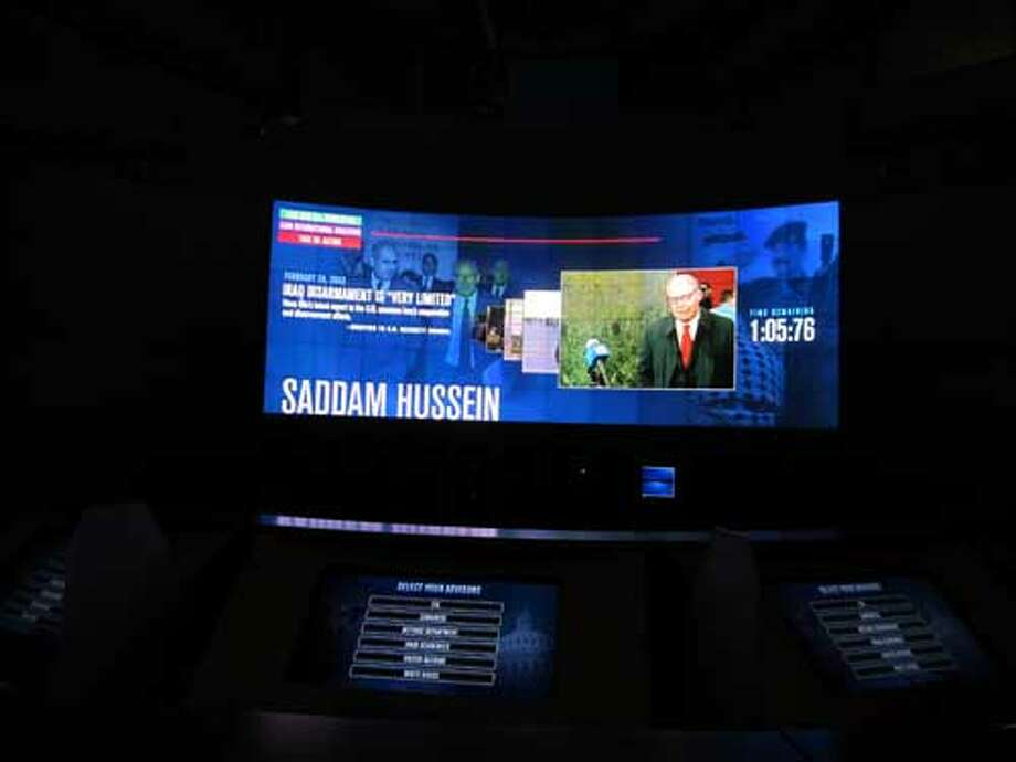 The Decision Points theater at the George W. Bush Presidential Library and Museum uses touch screen to allow visitors to explore policy points of view. Staff/David Hendricks