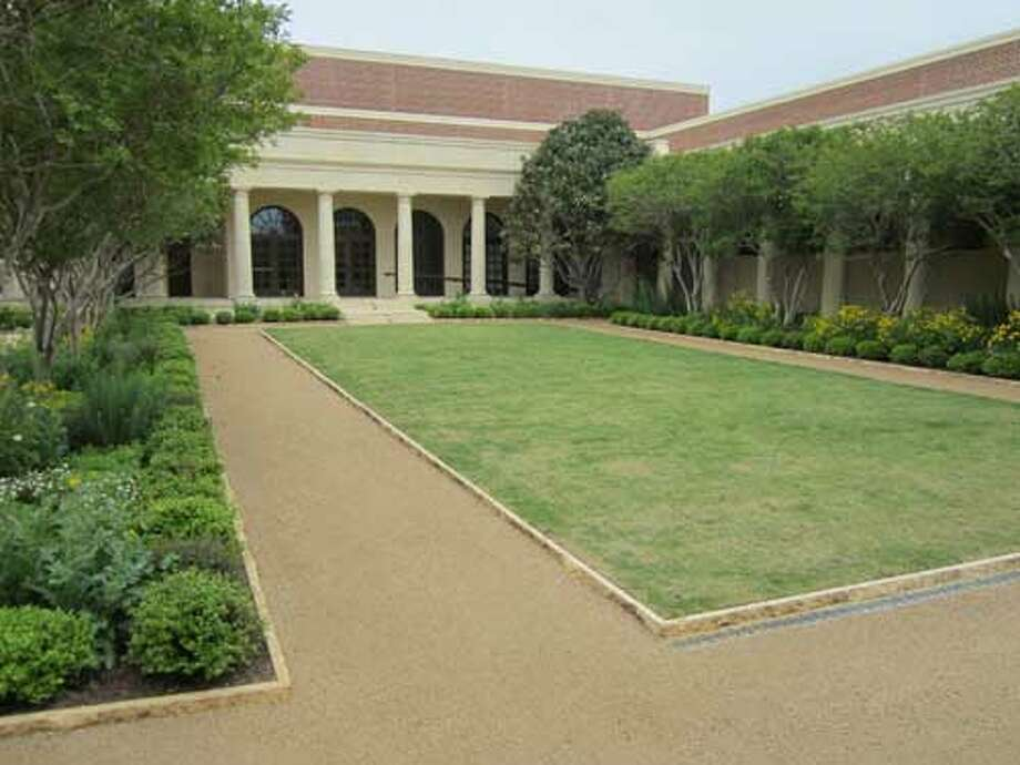 The Texas Rose Garden at the George W. Bush Presidential Library and Museum in Dallas is outside the museum's Oval Office replica.Staff/David Hendricks